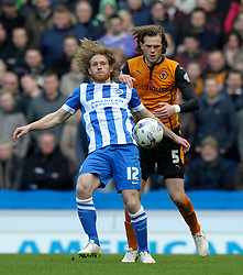 Brighton and Hove Albion's Craig Mackail-Smith challenges for the high ball with Wolverhampton Wanderers' Richard Stearman  - Photo mandatory by-line: Harry Trump/JMP - Mobile: 07966 386802 - 14/03/15 - SPORT - Football - Sky Bet Championship - Brighton v Wolves - Amex Stadium, Brighton, England.