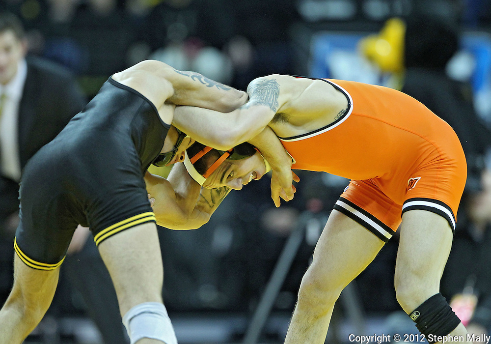 January 07, 2011: Iowa's Tony Ramos and Oklahoma State's Jordan Oliver battle for control during the 133-pound bout in the NCAA wrestling dual between the Oklahoma State Cowboys and the Iowa Hawkeyes at Carver-Hawkeye Arena in Iowa City, Iowa on Saturday, January 7, 2012. Ramos won 4-3.