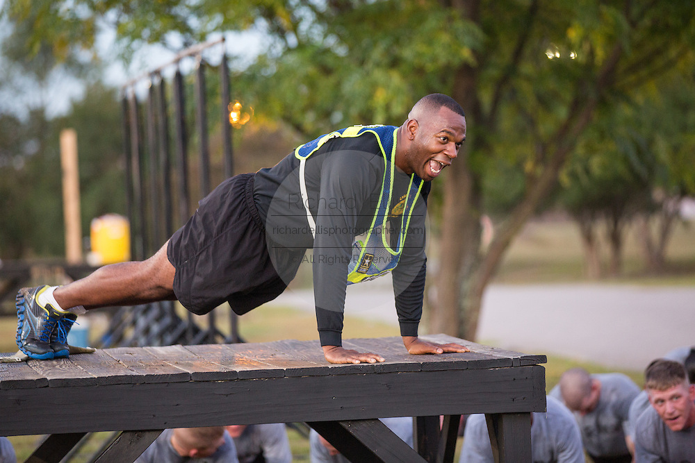 US Army First Sergeant Instructor Mark Halliburton leads Drill Sergeant candidates at the US Army Drill Instructors School Fort Jackson in early morning push ups September 27, 2013 in Columbia, SC. While 14 percent of the Army is women soldiers there is a shortage of female Drill Sergeants.