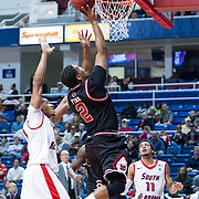 MOBILE, AL - DECEMBER 29:  Trey Finn #2 of the Arkansas State Red Wolves performs a layup in front of Augustine Rubit #21 of the South Alabama Jaguars at USA Mitchell Center on December 29, 2012 in Mobile, Alabama. At halftime Arkansas State leads South Alabama 28-23. (Photo by Michael Chang/Getty Images) *** Local Caption *** Trey Finn;Augustine Rubit