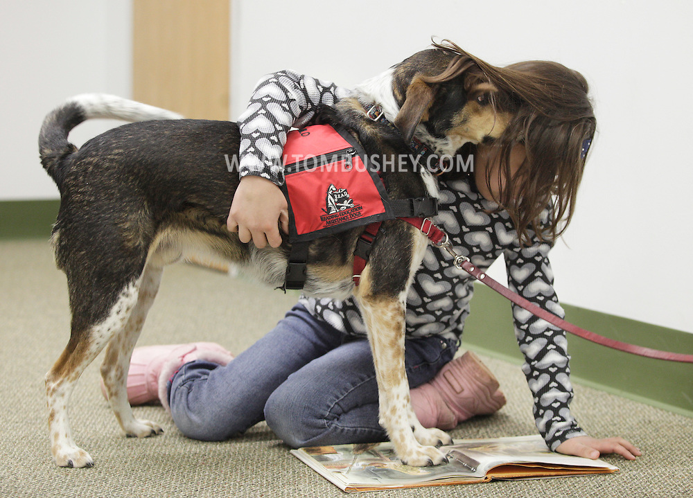 Isabella Peralta, 8, reads to Milo during the FURacious reading program at Cornwall Library on Friday, Feb. 25, 2011. Milo is a Reading Assistance Therapy Dog.