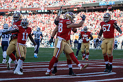 SANTA CLARA, CA - DECEMBER 17: Tight end Garrett Celek #88 of the San Francisco 49ers celebrates after scoring a touchdown against the Tennessee Titans during the second quarter at Levi's Stadium on December 17, 2017 in Santa Clara, California.  (Photo by Jason O. Watson/Getty Images) *** Local Caption *** Garrett Celek