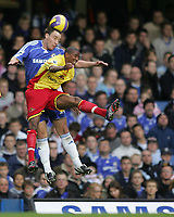 Photo: Lee Earle.<br /> Chelsea v Watford. The Barclays Premiership. 11/11/2006. Chelsea's John Terry (L) and Watford's Ashley Young battle in the air.