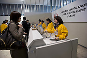 Travelers and business people book their flights at the airport in Natori, Miyagi Prefecture, Japan on 14 April, 2011. The airport, which, was badly damaged during the March 11 quake and tsunamis, reopened on April 13. .Photographer: Robert Gilhooly