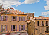 Pastel colored houses in the historic old town of Arles, France.