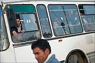 In Ras Jedir a bus is ready to bring refugee at a humanitarian camp named Shusha, 8 km away from the border. Plus de 140 000 réfugiés ont déjà quitté la Libye par la Tunisie ou l'Egypte et des milliers continuent d'arriver chaque jours. Jeudi 24 Février 2011, Ras Jedir, Tunisie..© Benjamin Girette/IP3 press