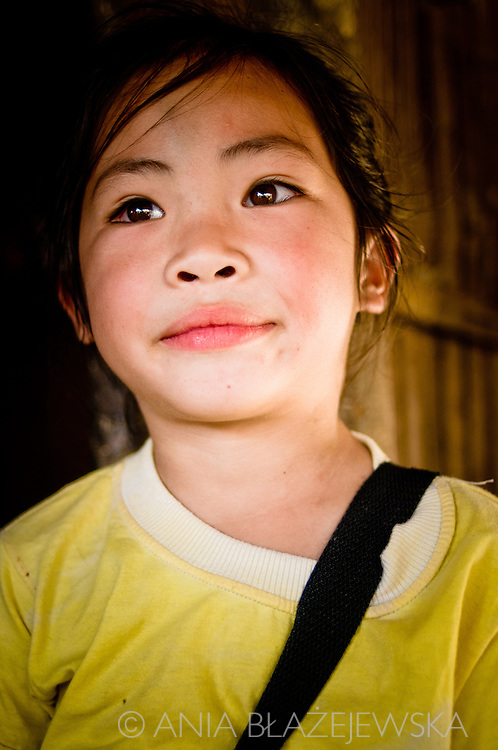 Laos, Muang Sing. Portrait of a young Lolo girl. <br /> Lolo is one of the ethnic minorities living in the north of Laos.