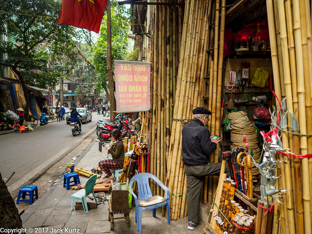 "24 DECEMBER 2017 - HANOI, VIETNAM: A shop selling bamboo in the old quarter of Hanoi. The old quarter is the heart of Hanoi, with narrow streets and lots of small shops but it's being ""gentrified"" because of tourism and some of the shops are being turned into hotels and cafes for tourists and wealthy Vietnamese.           PHOTO BY JACK KURTZ"