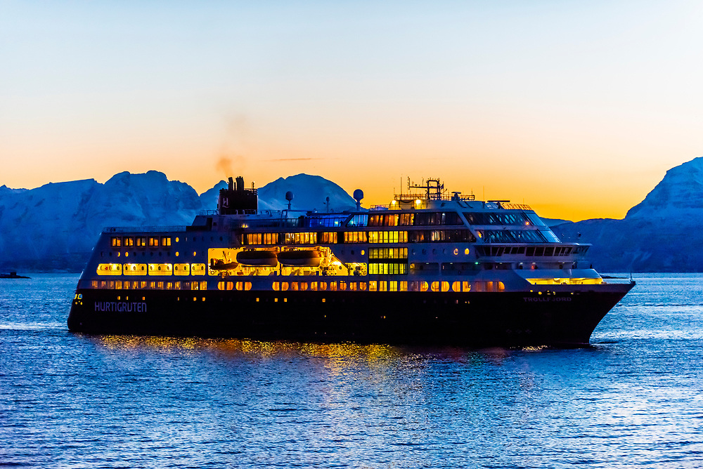 "The Hurtigruten ship ""Trollfjord"" arriving in Harstad predawn, Troms County, in Arctic Northern Norway."