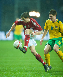 COPENHAGEN, DENMARK - Wednesday, November 19, 2008: Wales' Sam Vokes and Denmark's Daniel Agger during the international friendly match at the Brøndby Stadium. (Photo by David Rawcliffe/Propaganda)