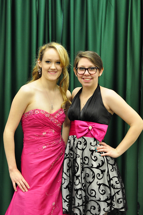 High school seniors and best friends Autumn Sauer and Kelley Johnson model dresses they've picked out for prom. The Sisterhood of the Traveling Dresses Project is hosted by the Ohio University WPA and a group of local women to provide prom and graduation dresses to Athens County high school girls in need.