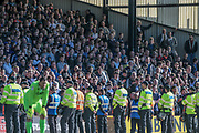 Bolton Wanderers fans with the police in front of them to ensure there is no further pitch invasions during the EFL Sky Bet League 1 match between Port Vale and Bolton Wanderers at Vale Park, Burslem, England on 22 April 2017. Photo by Mark P Doherty.