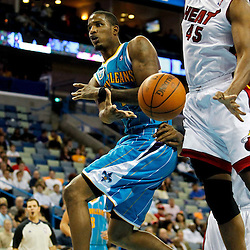 October 13, 2010; New Orleans, LA, USA; New Orleans Hornets small forward Trevor Ariza (1) passes under the basket past Miami Heat center Dexter Pittman (45) during the second quarter of a preseason game at the New Orleans Arena. Mandatory Credit: Derick E. Hingle