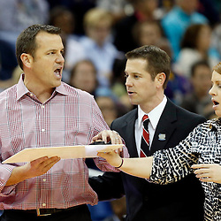 Apr 9, 2013; New Orleans, LA, USA; Louisville Cardinals head coach Jeff Walz (left) reacts against the Connecticut Huskies during the second half of the championship game in the 2013 NCAA womens Final Four at the New Orleans Arena. Mandatory Credit: Derick E. Hingle-USA TODAY Sports