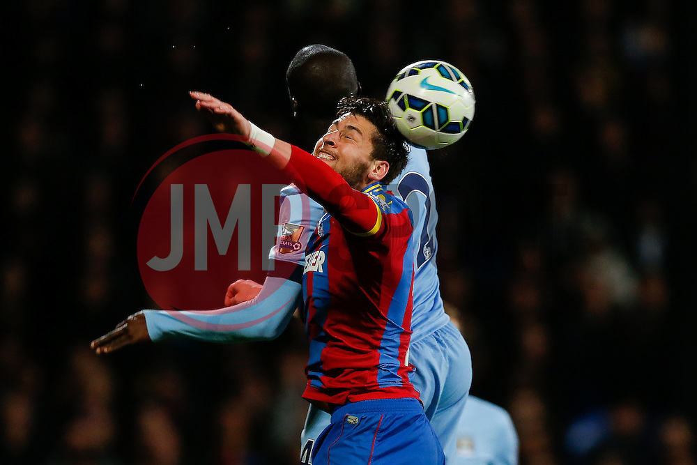 Joel Ward of Crystal Palace and Yaya Toure of Manchester City compete in the air - Photo mandatory by-line: Rogan Thomson/JMP - 07966 386802 - 06/04/2015 - SPORT - FOOTBALL - London, England - Selhurst Park - Crystal Palace v Manchester City - Barclays Premier League.