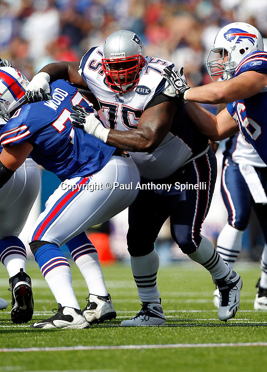 New England Patriots defensive tackle Vince Wilfork (75) works his way through a double team block during the NFL week 3 football game against the Buffalo Bills on Sunday, September 25, 2011 in Orchard Park, New York. The Bills won the game 34-31. ©Paul Anthony Spinelli