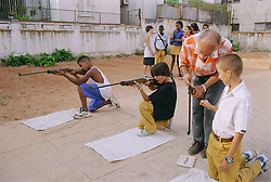 School children learning to shoot guns,