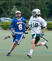 Gilford's Forest Aldridge defends Hopkinton's Bennett Mosseau during NHIAA DIvision III State Championship Lacrosse at Stellos Stadium in Nashua Tuesday evening.  (Karen Bobotas/for the Laconia Daily Sun)NHIAA Division III Lacrosse State Championships at Stellos Stadium June 7, 2011. NHIAA Division III Lacrosse State Championships at Stellos Stadium June 7, 2011.
