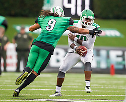 Oct 24, 2015; Huntington, WV, USA; North Texas Mean Green quarterback DaMarcus Smith is pressured by Marshall Thundering Herd linebacker Shawn Petty during the second quarter at Joan C. Edwards Stadium. Mandatory Credit: Ben Queen-USA TODAY Sports