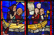 Mary of Egypt travelling to Jerusalem on a boat, from the stained glass window of St Mary of Egypt, 1215-25, in bay 21, in the ambulatory of Bourges Cathedral or the Cathedrale Saint-Etienne de Bourges, built 1195-1230 in French Gothic style and consecrated in 1324, in Bourges, Centre-Val de Loire, France. 22 of the original 25 medieval stained glass windows of the ambulatory have survived. The cathedral is listed as a UNESCO World Heritage Site. Picture by Manuel Cohen