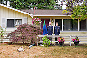 Mountlake Terrace, Washington - July 13, 2015: King Adam I, 19, his brother Prince Aaron, 17, and their cat Diamond, stand in front of &Uuml;berstadt's capitol, Rosewood (their house). According to King Adam I, &quot;Diamond was once the head of the Cat Party.&quot; When Uberstadt was partisan The Cat Party was the leading conservative faction. Now that Diamond is in retirement he's free to do his favorite things, which are hang around outside and &quot;lick himself.&quot; &quot;Now &Uuml;berstadt is a direct democracy, making parties irrelevant,&quot; said King Adam !. <br /> <br /> The Kingdom of &Uuml;berstadt is led by nineteen-year-old King Adam I, (Adam Oberstadt). The Barony of Rosewood -- the micronation's capitol and the Oberstadt family home -- is nestled in the Seattle suburb of Mountlake Terrace, Wash. <br /> &Uuml;berstadt also claims territory of nearby Edmount Island on Lake Ballinger -- called The Barony of Ballinger and &quot;considered the spiritual homeland of the nation.&quot; Both baronies reside within the Duchy of Edmount which &quot;is situated entirely within the boundaries of the city of Mountlake Terrace, Washington,&quot; according to the &Uuml;berstadt website.<br /> &Uuml;berstadt  was founded by King Adam I and his high school friends March 6, 2010, and was governed by judges as a kritarchy. Before taking the crown, Adam was &Uuml;berstadt's chief judge. After graduation, many of the &Uuml;berstadti moved away to college and &Uuml;berstadt's populace shrank. Activities would shift from the high school to Rosewood, and the governing style morphed to a unitary constitutional monarchy. According to the micronation's website &Uuml;berstadt is a sovereign state &quot;guided by the principles of direct democracy, socialist economics, and environmentalism.&quot; <br /> <br /> CREDIT: Matt Roth