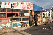 Calais, Pas-de-Calais, France - 16.10.2016    <br />     <br />  Some refugees open small shops and restaurants inside the camp. &rdquo;Jungle&quot; refugee camp on the outskirts of the French city of Calais. Many thousands of migrants and refugees are waiting in some cases for years in the port city in the hope of being able to cross the English Channel to Britain. French authorities announced that they will shortly evict the camp where currently up to up to 10,000 people live.<br /> <br /> Einige Fluechtlinge eroeffneten kleine Geschaefte und Restaurants in dem Camp. &rdquo;Jungle&rdquo; Fluechtlingscamp am Rande der franzoesischen Stadt Calais. Viele tausend Migranten und Fluechtlinge harren teilweise seit Jahren in der Hafenstadt aus in der Hoffnung den Aermelkanal nach Gro&szlig;britannien ueberqueren zu koennen. Die franzoesischen Behoerden kuendigten an, dass sie das Camp, indem derzeit bis zu bis zu 10.000 Menschen leben K&uuml;rze raeumen werden. <br /> <br /> Photo: Bjoern Kietzmann