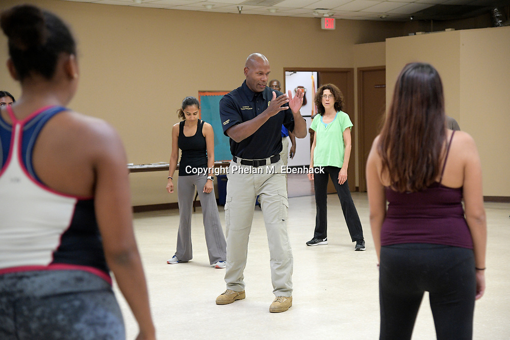 Corporal Kevlon Kirkpatrick, of the Orlando Police Department, teaches a self-defense class for women at the Dr. J. B. Callahan Neighborhood Center in the historic Parramore neighborhood of downtown Orlando, Fla., Tuesday, July 25, 2017. (Photo by Phelan M. Ebenhack)