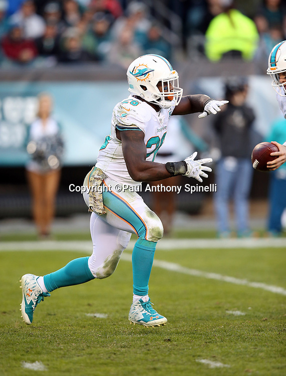 Miami Dolphins running back Lamar Miller (26) takes a handoff during the 2015 week 10 regular season NFL football game against the Philadelphia Eagles on Sunday, Nov. 15, 2015 in Philadelphia. The Dolphins won the game 20-19. (©Paul Anthony Spinelli)