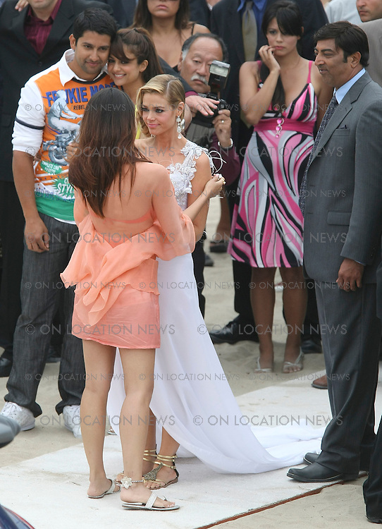 OXNARD, CALIFORNIA - Thursday 31st JULY 2008 ***EXCLUSIVE*** Denise Richards films a wedding scene with Bollywood film star Akshay Kumar for the Bollywood film called Kambakkht Ishq. In this beachside wedding scene, Denise and Akshay are  about to be married when Akshay has a change of heart and leaves Denise at the alter as he leaves with former Miss World and Bollywood Actress Kareena Kapoor. The film is a romantic comedy about an Indian stuntman who takes Hollywood by storm but cannot find true love. Akshay Kumar has appeared in over 80 Hindi language films and he is known as an action hero of Bollywood. Kambakkht Ishq is the highest budgeted film in Bollywood history and the film is expected to be a worldwide commercial success. Photograph: On Location News. Sales: Eric Ford 1/818-613-3955 info@OnLocationNews.com