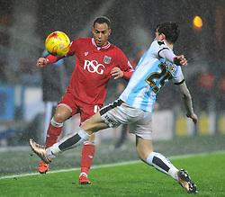 Elliott Bennett of Bristol City is closed down by Ben Chilwell of Huddersfield Town - Mandatory byline: Dougie Allward/JMP - 12/12/2015 - Football - St John Smith's Stadium - Huddersfield, England - Huddersfield Town v Bristol City - Sky Bet Championship
