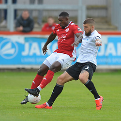 TELFORD COPYRIGHT MIKE SHERIDAN Shane Sutton of Telford and Lee Ndlovu during the National League North fixture between Brackley Town and AFC Telford United at St James's Park on Saturday, September 7, 2019<br /> <br /> Picture credit: Mike Sheridan<br /> <br /> MS201920-016