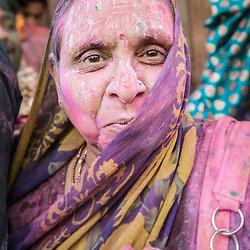 Coloured woman after celebrations of Holi festival, Vrindavan, India