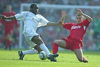 Photo: Chris Brunskill, Digitalsport<br /> Liverpool v Bolton Wanderers . FA Barclays Premiership. 02/04/2005.  John Welsh of Liverpool challenges Jay Jay Okocha of Bolton.
