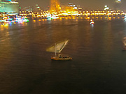 Motion blur night shot of a traditional boat on the Nile River, Cairo, Egypt