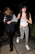 10.MARCH.2009 - LONDON<br /> <br /> **THESE PICTURES ARE EXCLUSIVE**<br /> <br /> AMY WINEHOUSE ARRIVING AT A FRIENDS BIRTHDAY PARTY AT A PRIVATE ADDRESS IN ARCHWAY AT 9.30PM ALL DRESSED UP WITH A BIG CLEVAGE SHOWING AND WITH BLOOD ON HER LEG SHE STAYED AT THE PARTY TILL 3.30AM AND LEFT IN A CHANGE OF CLOTHES JEANS AND VEST WITH WRITING ALL OVER HER HANDS CUDDLING UP TO HER MATE WHO WAS DRINKING A CAN OF BEER BEFORE THEY ALL WENT BACK TO AMY'S TO CONTINUE THE PARTY.<br /> <br /> BYLINE MUST READ : EDBIMAGEARCHIVE.COM<br /> <br /> *THIS IMAGE IS STRICTLY FOR UK NEWSPAPERS & MAGAZINES ONLY*<br /> *FOR WORLDWIDE SALES & WEB USE PLEASE CONTACT EDBIMAGEARCHIVE-0208 954 5968*