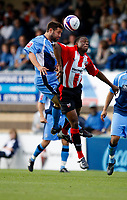 Photo: Richard Lane/Richard Lane Photography. Wycombe Wanderers v Brentford. Coca Cola Fotball League Two. 13/09/2008. Wycombe's Tommy Doherty and Brentford's Marcus Bean (rt) challenge for the ball.