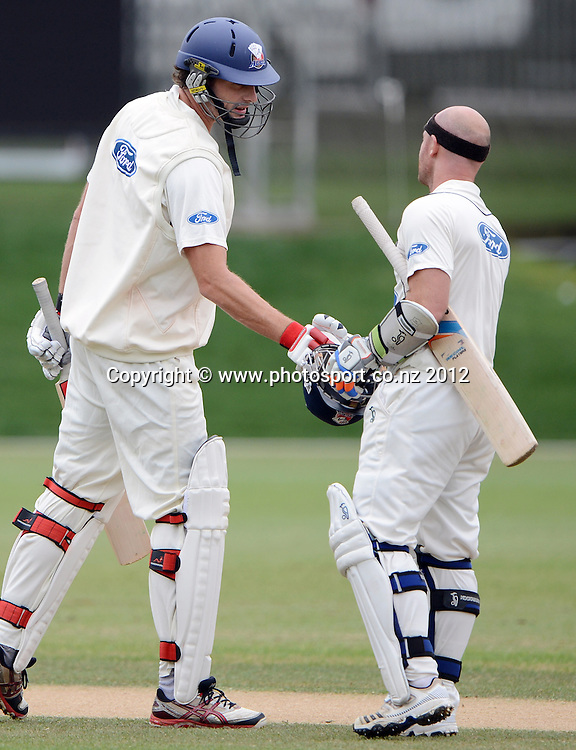 Auckland captain Gareth Hopkins celebrates his century as he is congratulated by Kyle Mills. Plunket Shield Cricket, Auckland Aces v Canterbury Wizards at Eden Park Outer Oval. Auckland on Tuesday 18 December 2012. Photo: Andrew Cornaga/Photosport.co.nz