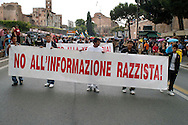 Rome  July 8 2008.Demonstrators protest against the discrimination of Roma and Sinti..The banner reads  'stop the racist information'.Manifestazione nazionale  di Rom e Sinti contro lil razzismo
