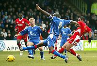 Photo: Chris Ratcliffe.<br />Gillingham v Bristol City. Coca Cola League 1. 26/12/2005.<br />Scott Murray (R) of Bristol City scores as Ian Cox (C) and  Danny Jackman try and close him down.