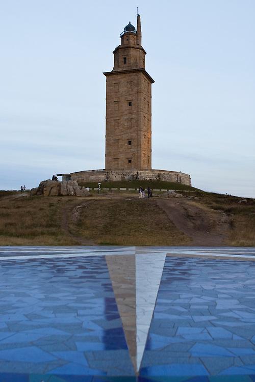 Hecules Tower in La Coruna (Spain) with the Compass Rose made of tiles at its feet. Spain UNESCO World Heritage Site.<br /> <br /> Torre de H&eacute;rcules, en A Coru&ntilde;a, con &quot;La Rosa de los VIentos&quot;, realizada con baldosines al pie del faro. Declarada Patrimonio de la Humanidad por la UNESCO en 2009.