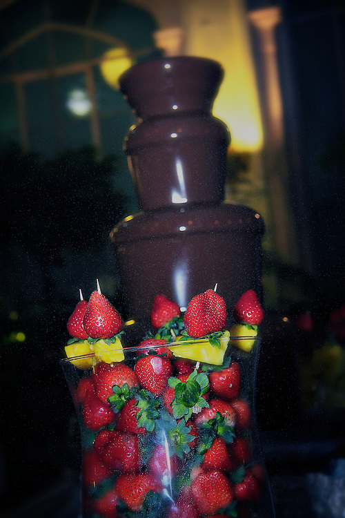 Chocolate fountain with strawberries and pineapple.