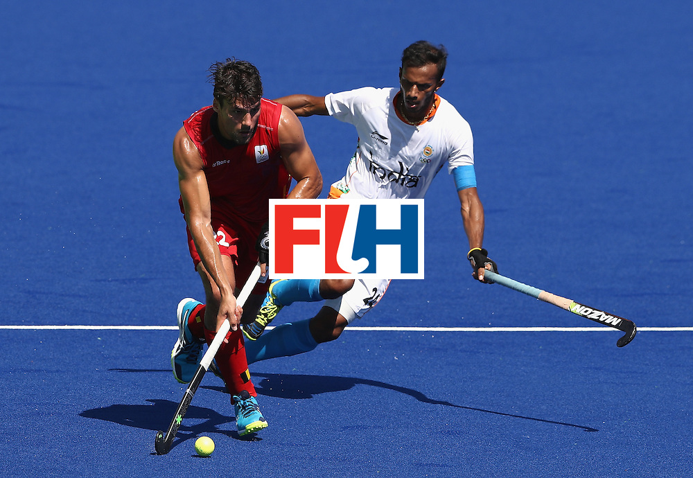 RIO DE JANEIRO, BRAZIL - AUGUST 14:  Simon Gougnard of Belgium is challenged by Sunil Sowmarpet during the Men's hockey quarter final match between Belgium and India on Day 9 of the Rio 2016 Olympic Games at the Olympic Hockey Centre on August 14, 2016 in Rio de Janeiro, Brazil.  (Photo by David Rogers/Getty Images)
