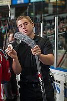 KELOWNA, CANADA - NOVEMBER 7: Brendan Hait, equipment manager of the Kelowna Rockets waxes a stick on the bench against the Spokane Chiefs on November 7, 2014 at Prospera Place in Kelowna, British Columbia, Canada.  (Photo by Marissa Baecker/Shoot the Breeze)  *** Local Caption *** Brendan Hait;