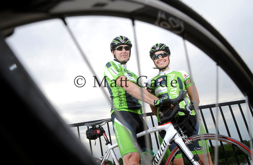 John Meachum of Ada and Chelsea Clark of Grand Rapids are pictured in downtown Lowell as they will compete in the West Michigan Stage Race on Saturday and Sunday. The Sunday race will begin and end in Lowell..Date Shot 5-15-2012.(Matt Gade | MLive.com)