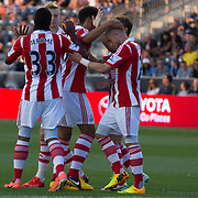 Stoke City F.C. Midfielder MICHAEL KIGHTLY (21) celebrates with his teammates after scoring in the 12th minute of a MLS regular season international friendly match against the Philadelphia Union Tuesday, July. 30, 2013 at PPL Park in Chester PA.