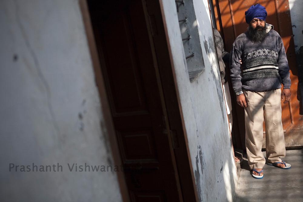 "Charnjeet Singh an addict looks on at ""Navjeevan"" drug rehabilitation center in Amritsar, India, on Wednesday, December 15, 2010. Photographer: Prashanth Vishwanathan/HELSINGIN SANOMAT"