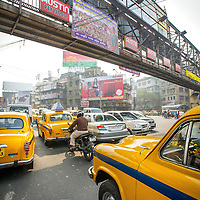 Jan 13, 2013 - Taxi cabs and other vehicles clog the streets of Kolkata, India as more than 75% of the vehicles in Kolkata have managed to skip out on the government mandated anti-pollution control testing. The pollution measurements are 20% to 50% higher than safe limits at many parts of the city.<br /> <br /> <br /> Story Summary: It is said that the battle over global warming is to be won or lost in Asia. With growing populations and new economic boom in the global markets across Asia countries like India, Nepal and Cambodia have to grapple with the success and the environmental disaster that comes with ramped up production in unchecked or unregulated industries to compete in todays marketplace. The catastrophic air pollution makes for new problems to be dealt with such as a future health crisis, quality of life issues and the tarnished image of reduced visibility to world heritage sites for tourism.