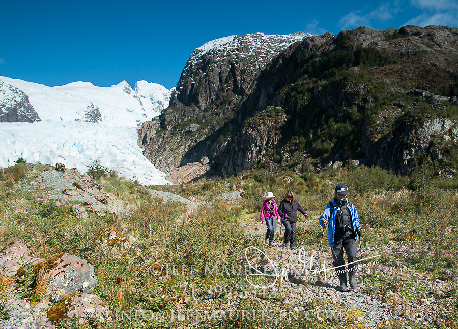 Women hikers visit Bernal glacier (Benito glacier) located in Alacalufes National Reserve, Southern Chilean Fjords.