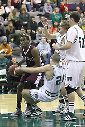 15 December 2012:  Nate Brooks bumps Pate Sodeman out of his way going for the hoop during an NCAA mens division 3 basketball game between theUniversity of Chicago Maroons and the Illinois Wesleyan Titans in Shirk Center, Bloomington IL