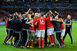 LILLE, FRANCE - Friday, July 1, 2016: Wales players celebrates a 3-1 victory over Belgium and reaching the Semi-Final during the UEFA Euro 2016 Championship Quarter-Final match at the Stade Pierre Mauroy. (Pic by David Rawcliffe/Propaganda)